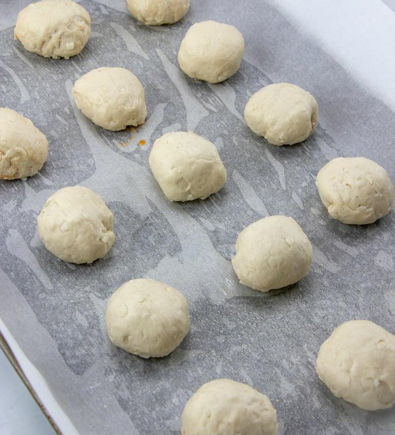 Cheesy Pizza Bombs - raw pizza balls on baking sheet