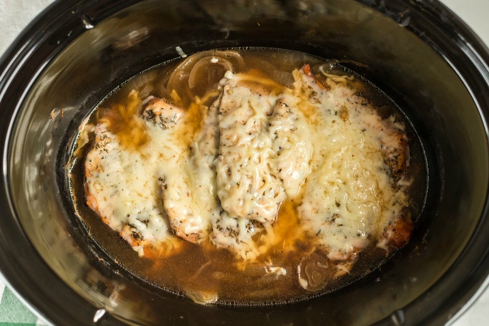 Crockpot French Onion Chicken - melted cheese on top of chicken