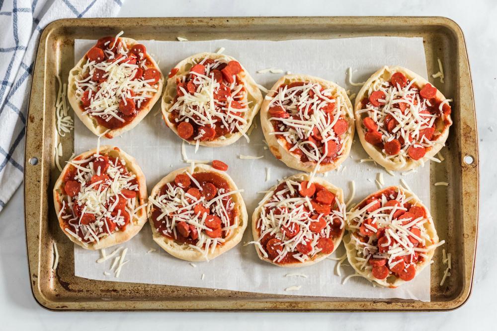 English Muffin Pizza Lunchbox Idea - English muffin pizzas on baking sheet