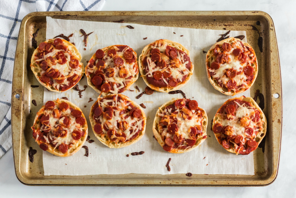 English Muffin Pizza Lunchbox Idea - cooked English muffin pizzas on baking sheet