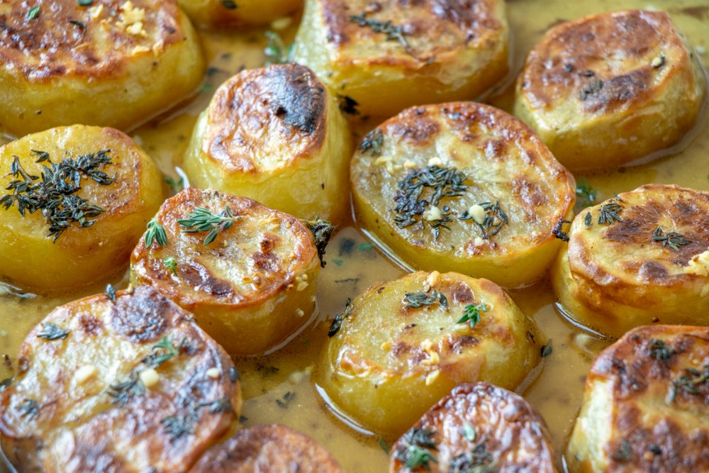 Melting Potatoes Recipe - potatoes cooked on baking sheet with butter, seasonings and broth