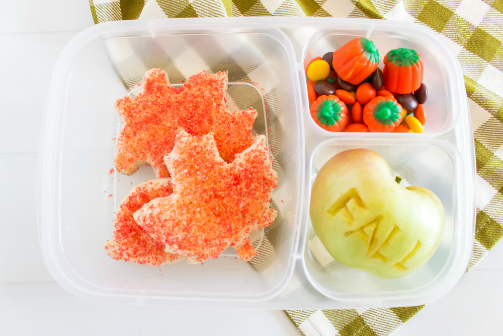 Cute Fall Lunchbox Ideas - fall leaves, apple and candy mix packed for lunch