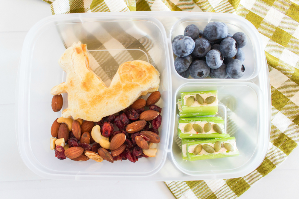 Cute Fall Lunchbox Ideas - squirrel shaped quesadilla, nut mix, celery and blueberries packed for lunch