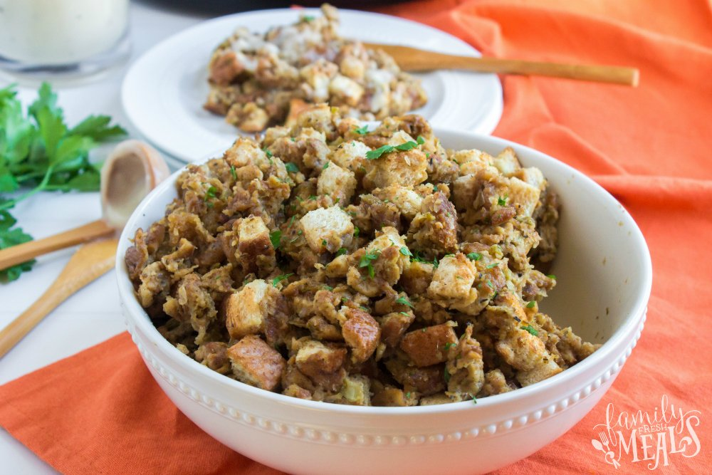 Easy Crockpot Stuffing - cooked stuffing in a white bowl