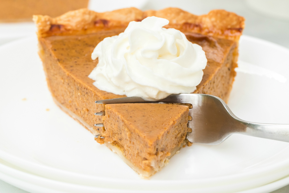 Easy Homemade Pumpkin Pie Recipe - fork taking a piece of pie