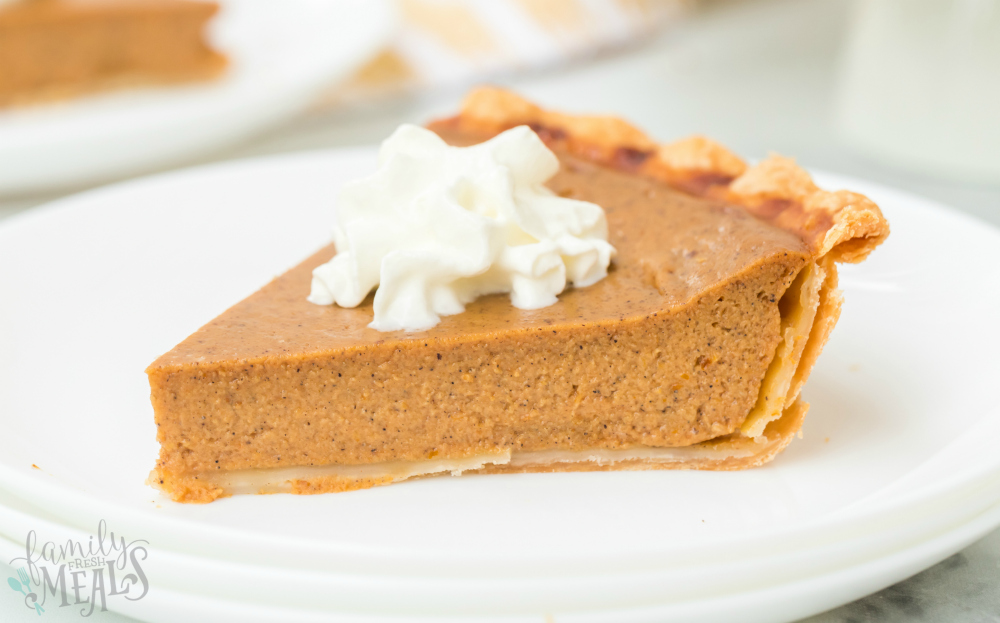 Easy Pumpkin Pie Recipe - slice of pumpkin pie on white plate