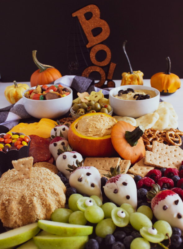 Halloween Appetizer Snack Board Idea - Spooky fun food on a black food board