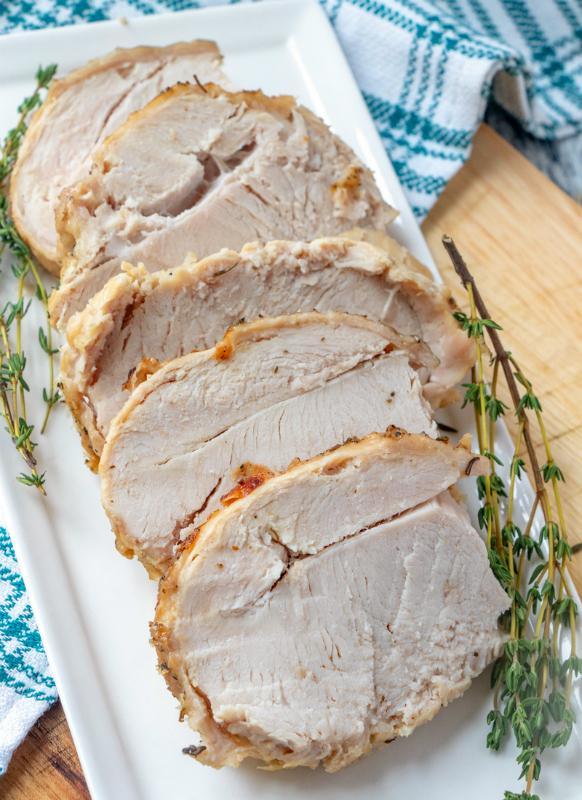 Instant Pot Turkey Breast - turkey breast sliced on a white plate