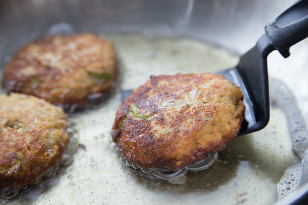 Easy Crab Cakes - crab patties cooking in pan