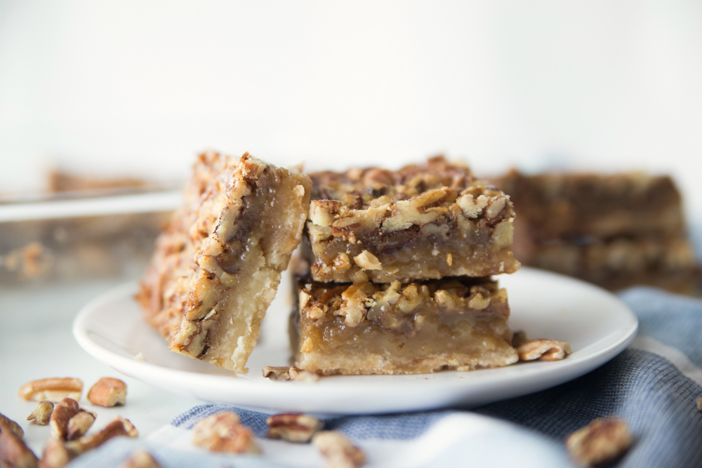 Pecan Pie Bars - served on a white plate