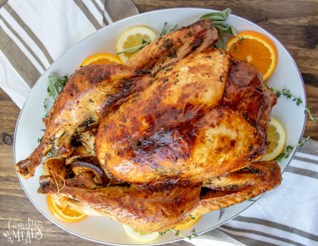 Roasted Thanksgiving Turkey Recipe - roasted turkey served on a large plate