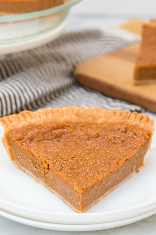 Sweet Potato Pie - Slice of pie served on a white plate