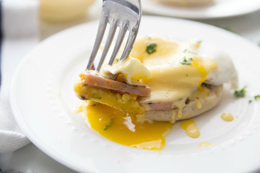 Easy Blender Hollandaise Sauce Recipe - served over eggs Benedict