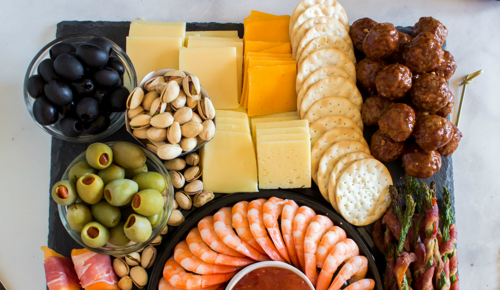 New Years Appetizer Meat and Cheese Board - Cheese, crackers, meatballs, olives and nuts