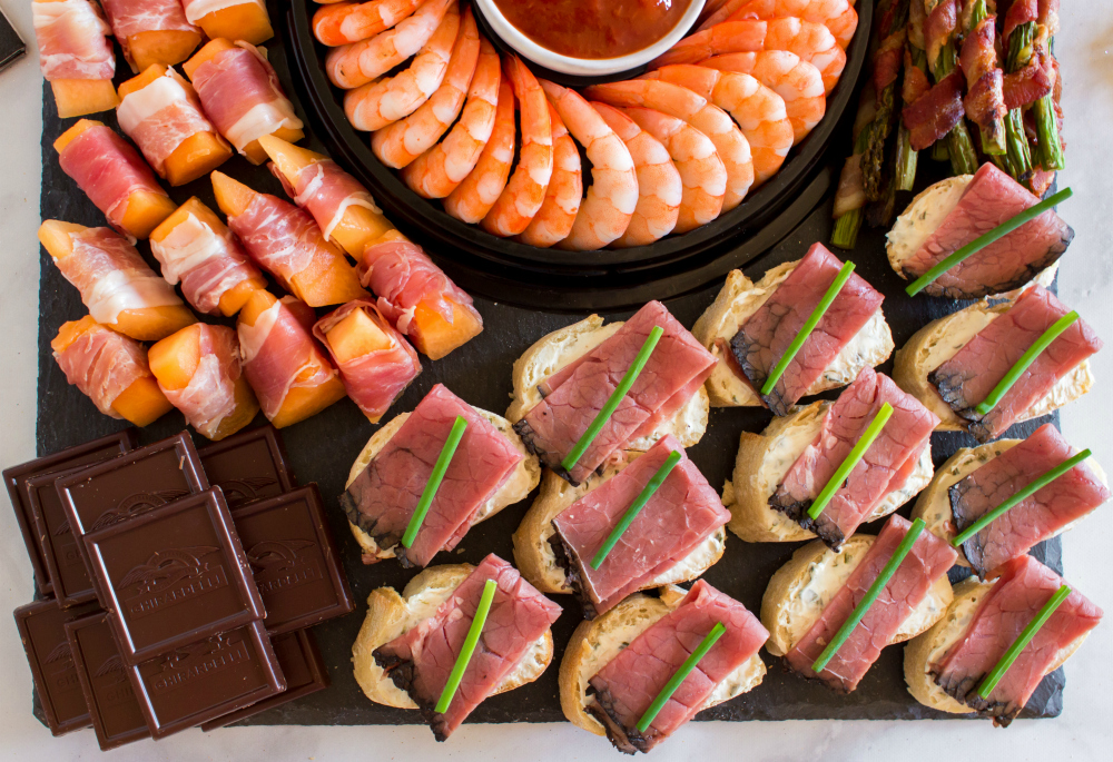 New Years Appetizer Meat and Cheese Board - proccuito wrapped melon, chocolate and beef canapé