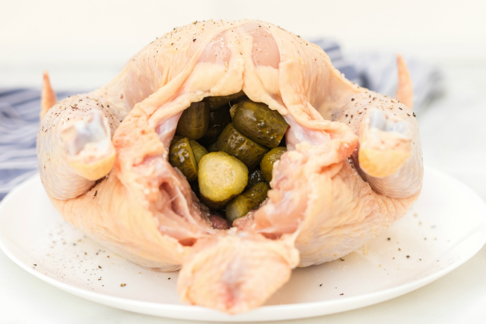 Instant Pot Dill Pickle Chicken Recipe - whole chicken stuffed with sliced dill pickles