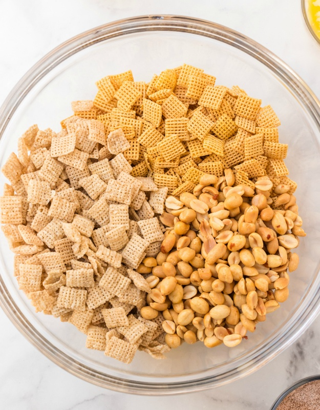 Churro Chex Mix - ingredients in glass mixing bowl