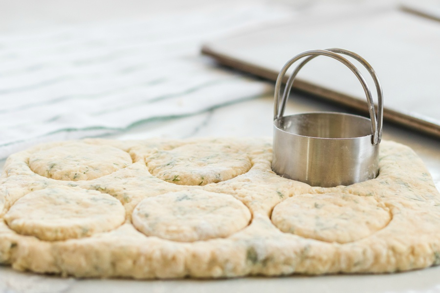 cutting biscuits out with biscuit cutter