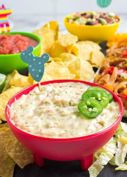 Cinco De Mayo Appetizer Board - cheese dip served in a red bowl