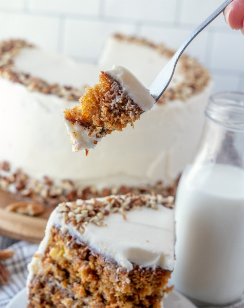 The Best Carrot Cake Recipe - fork picking up a piece of cake