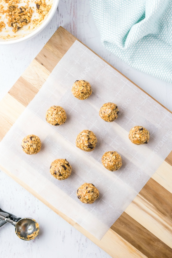 Energy bites lined up on parchment paper
