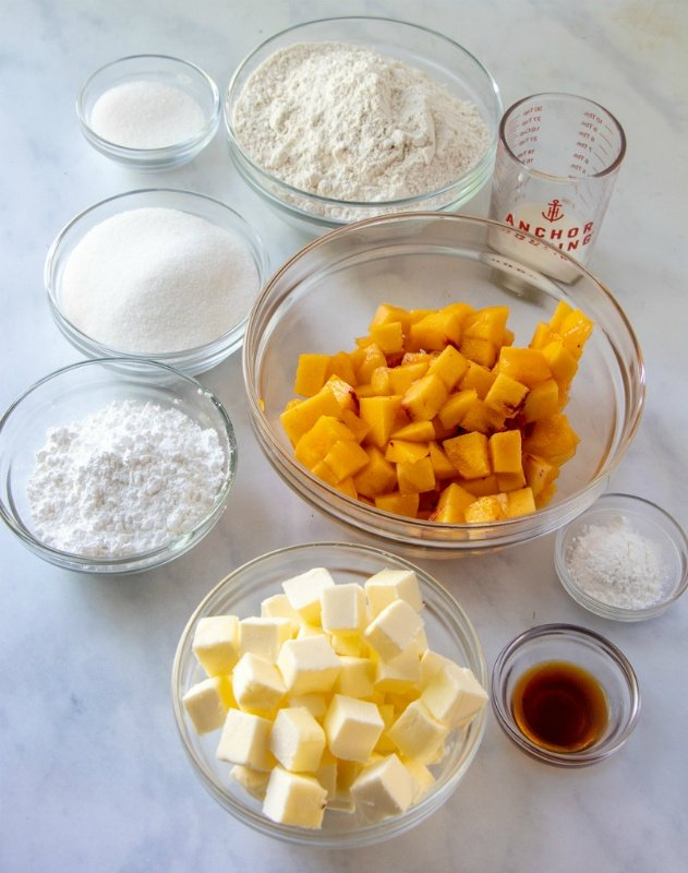 Peach Crumble Bars ingredients for the recipe in glass mixing bowls