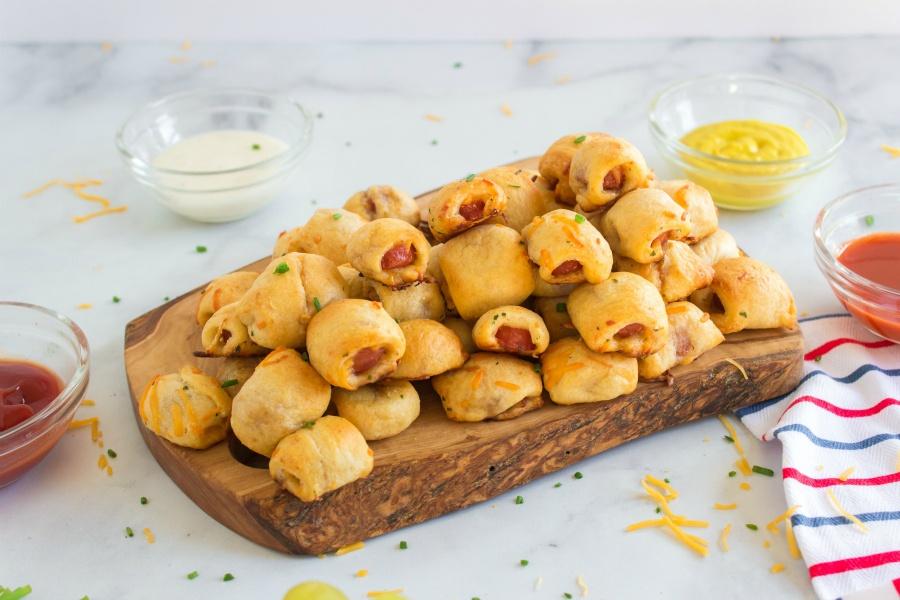 hotdog nuggets on a wooden serving platter