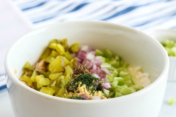 ngredients for cottage cheese tuna salad in white mixing bowl on the table