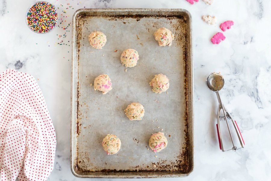 Cookie batter balls, on a baking pan
