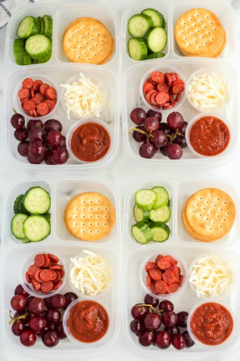 - top down image of 4 DIY Pizza Lunchable lunchboxes