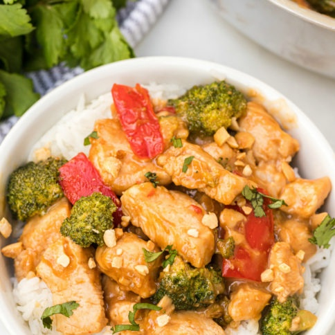 Easy Thai Peanut Chicken Recipe served in a white bowl over rice