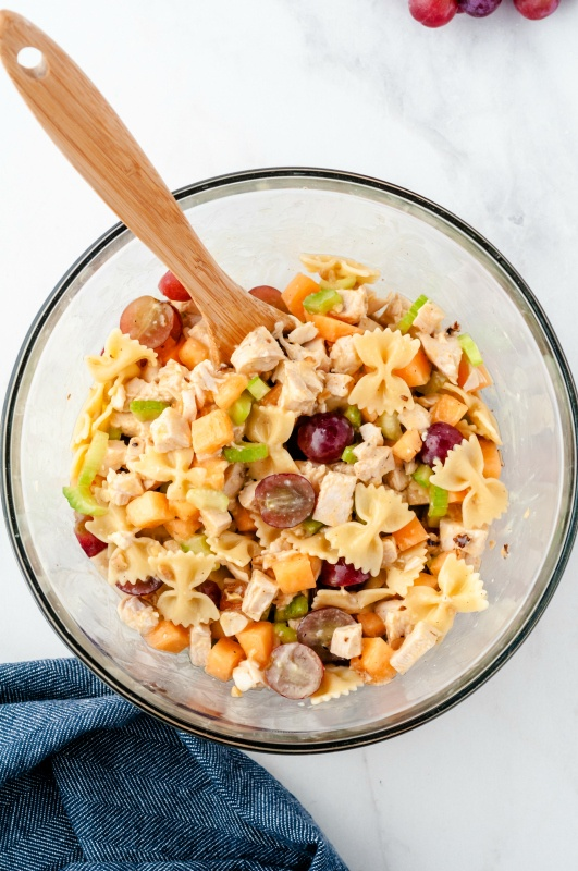 Fresh fruity chicken pasta salad in a glass bowl