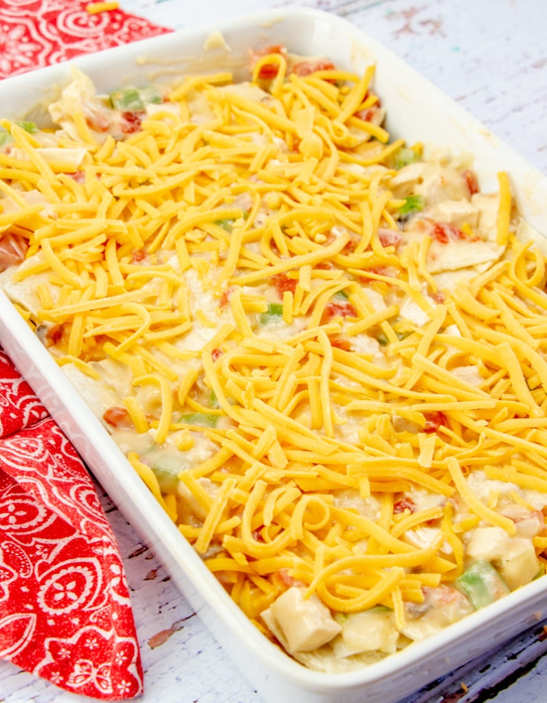 King Ranch Chicken Casserole in a baking dish topped with shredded cheese
