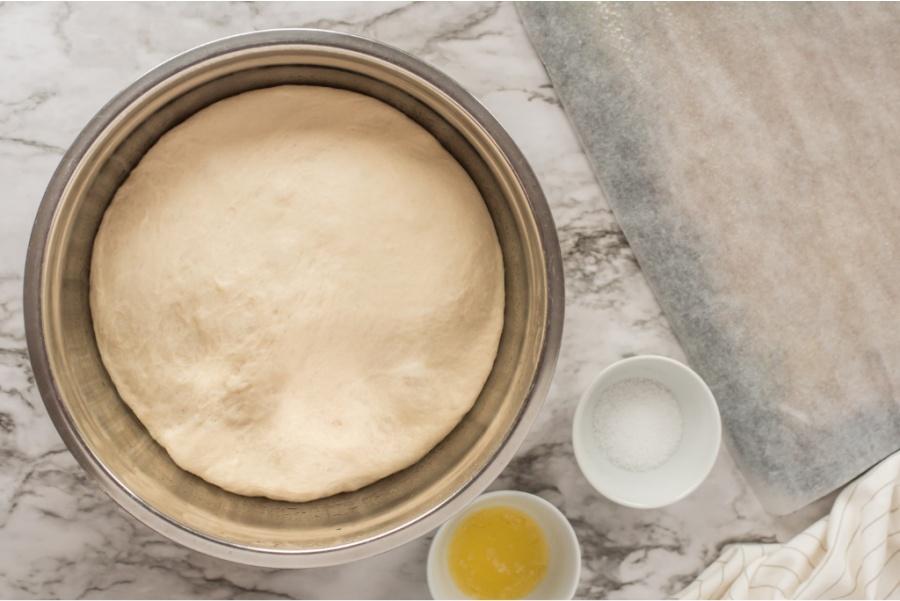 pretzel dough sitting in mixing bowl