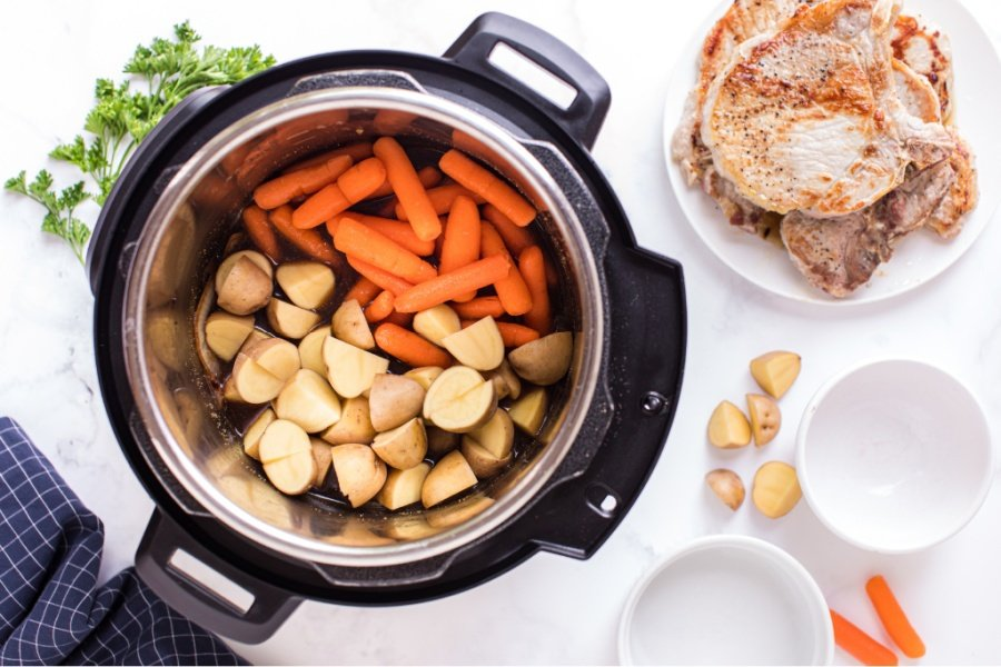 top down image of potatoes and carrots in the instant pot