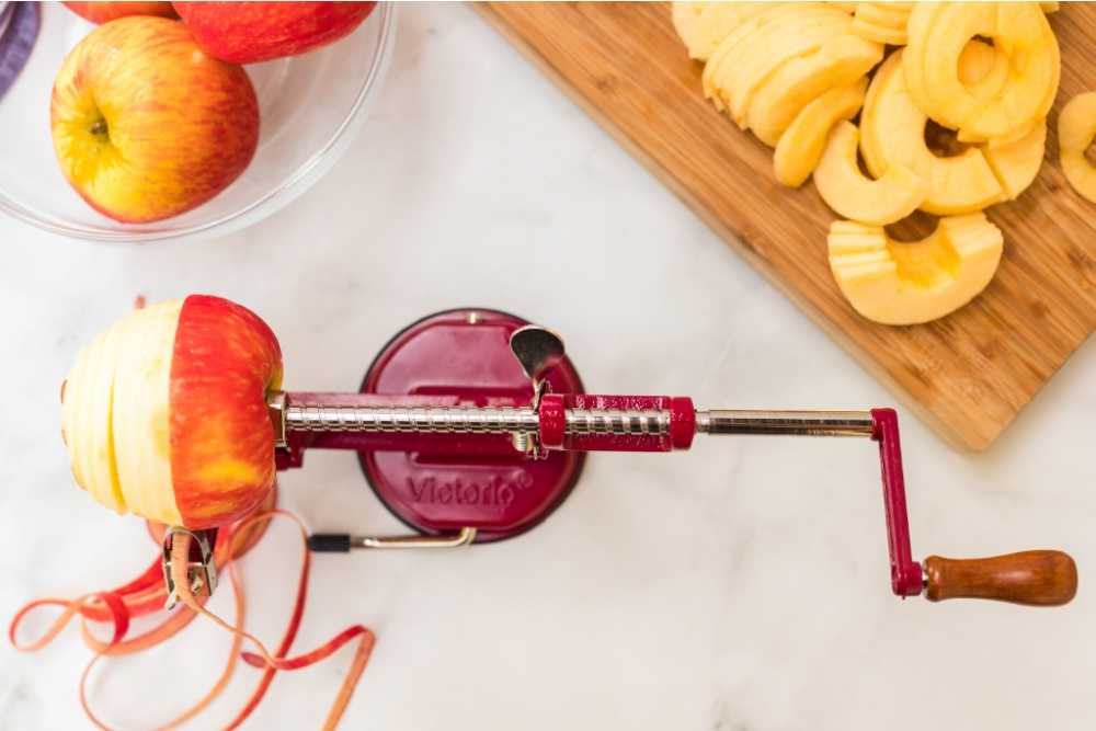 apple being peeled on an apple peeler