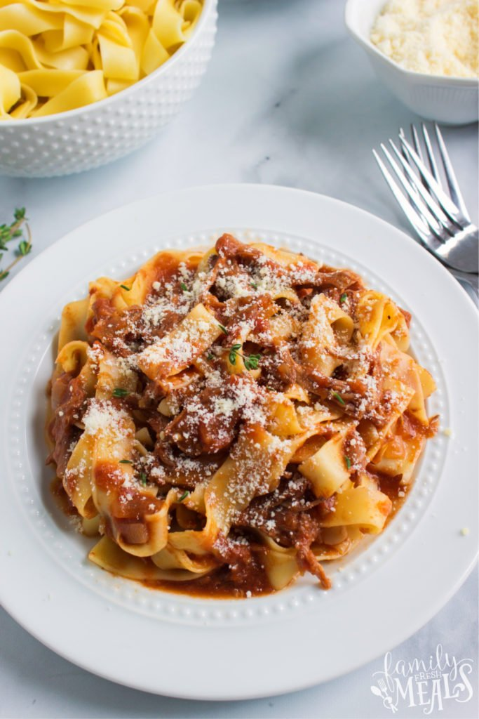 ragu served with noodles on a white plate