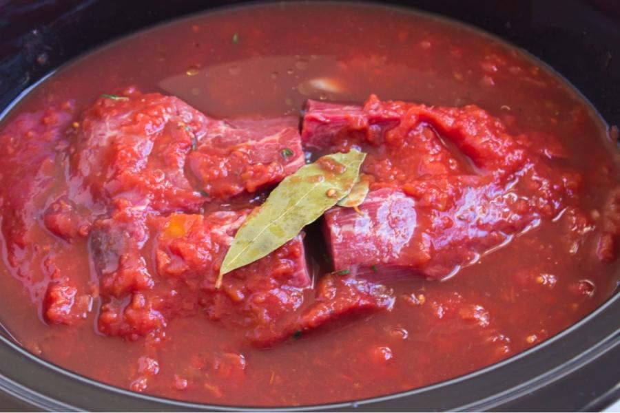 ingredients for Beef Ragu in black crockpot