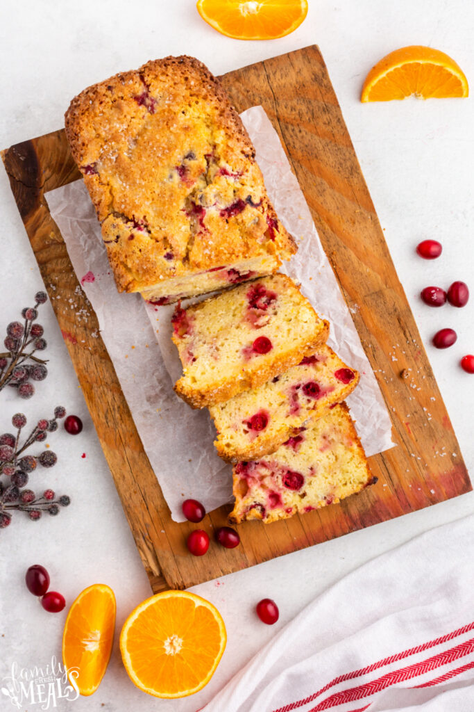 Cranberry Orange Bread cut into slices on cutting board