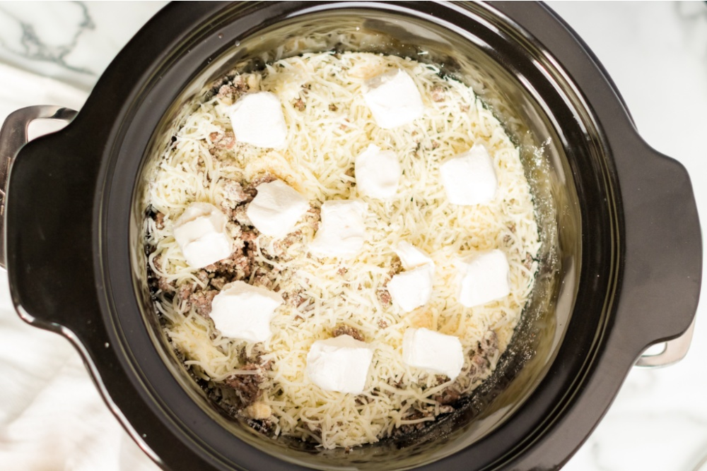 browned beef, Parmesan cheese mozzarella cheese added into slow cooker