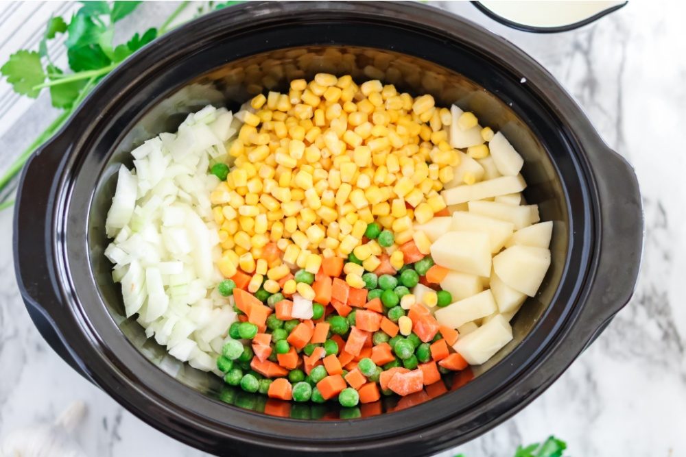 ingredient for Chicken Pot Pie Soup in a slow cooker