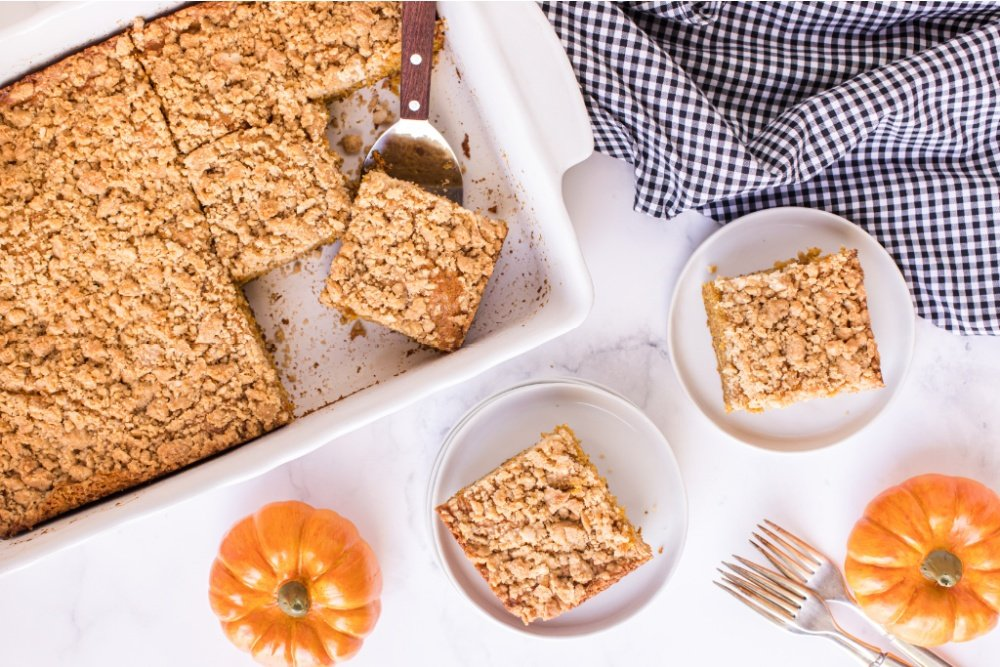 pan of pumpkin coffee cake, with some pieces removed and on plates
