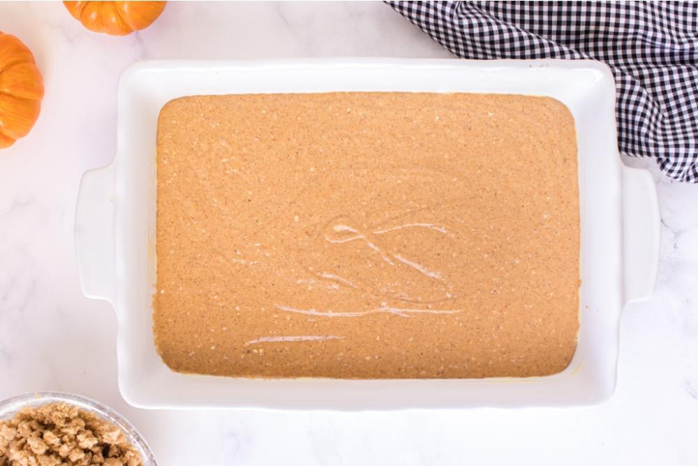 cake batter in a baking pan