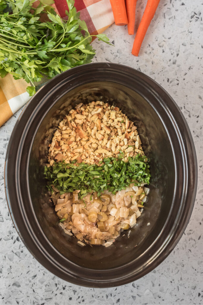 stuffing mix , celery, onion and parsly in the bottom of a slow cooker