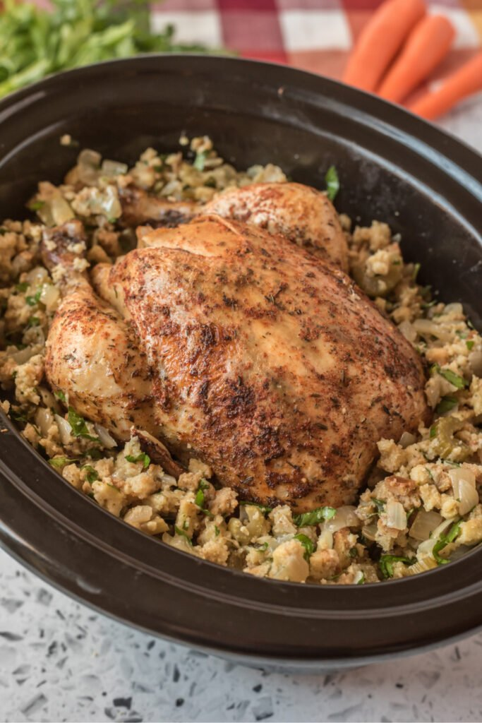 Whole chicken and stuffing in a slow cooker