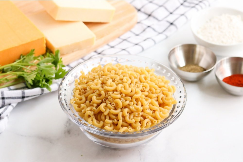 uncooked pasta in a glass bowl