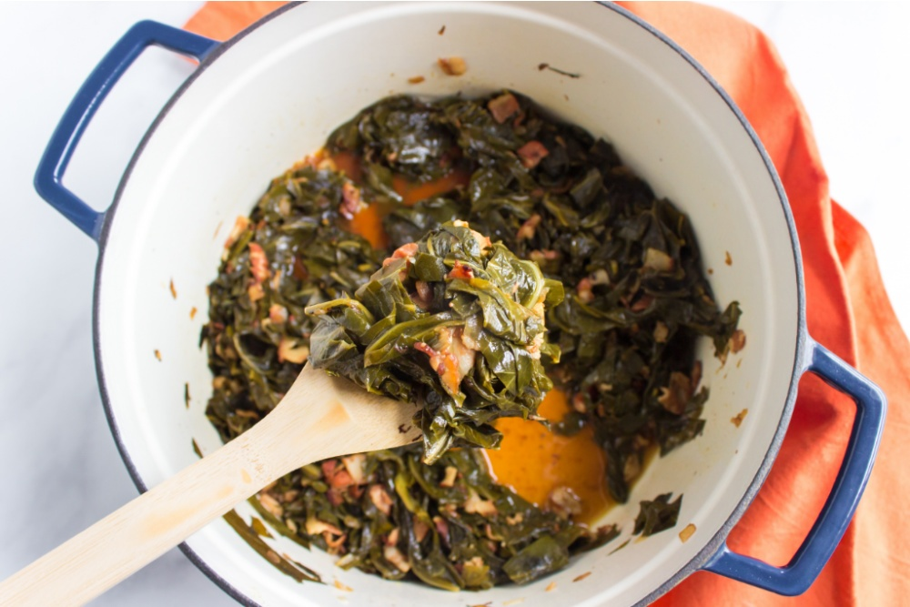 cooked southern collard greens in a cooking pot