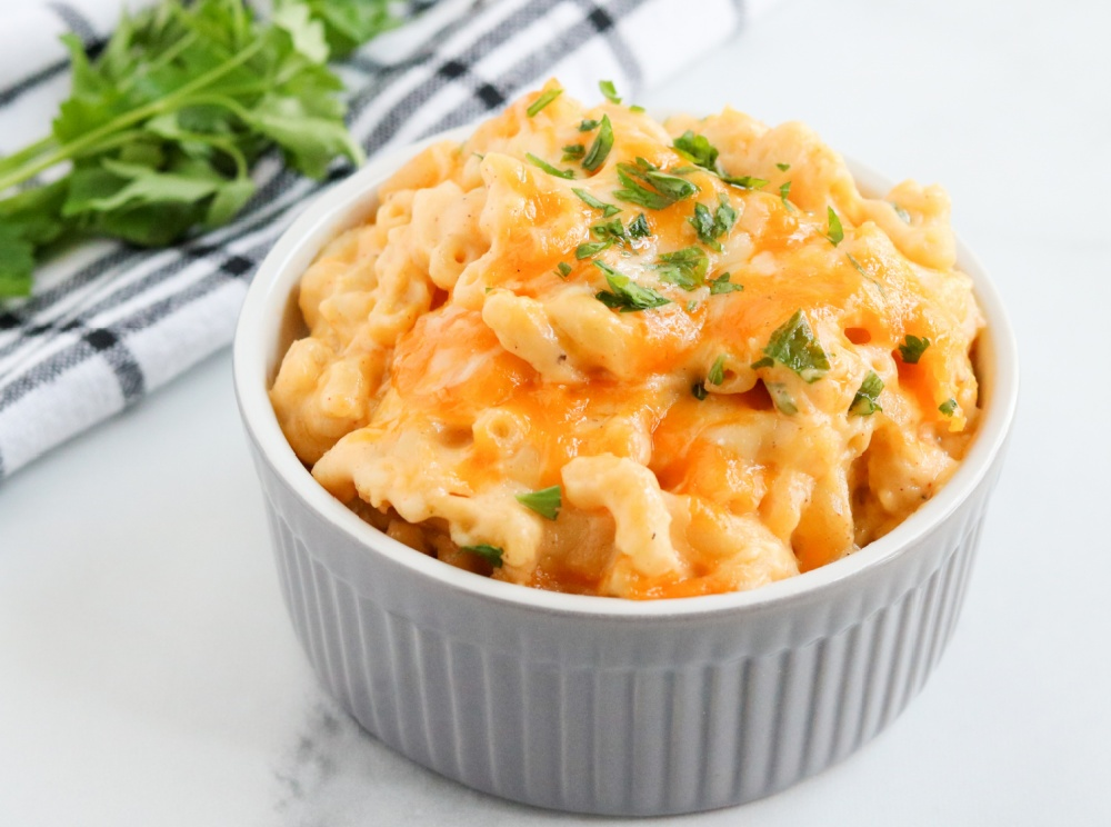 baked mac and cheese in a small white dish