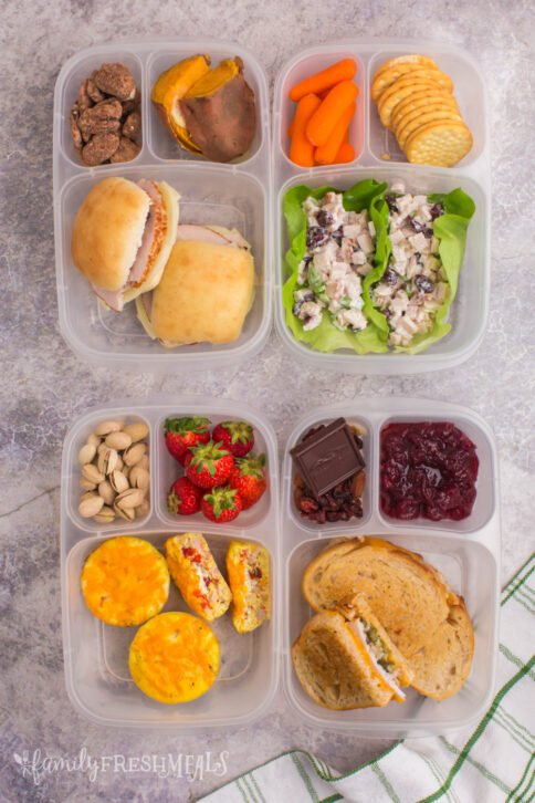 top down image of 4 lunchboxes packed with Thanksgiving leftovers
