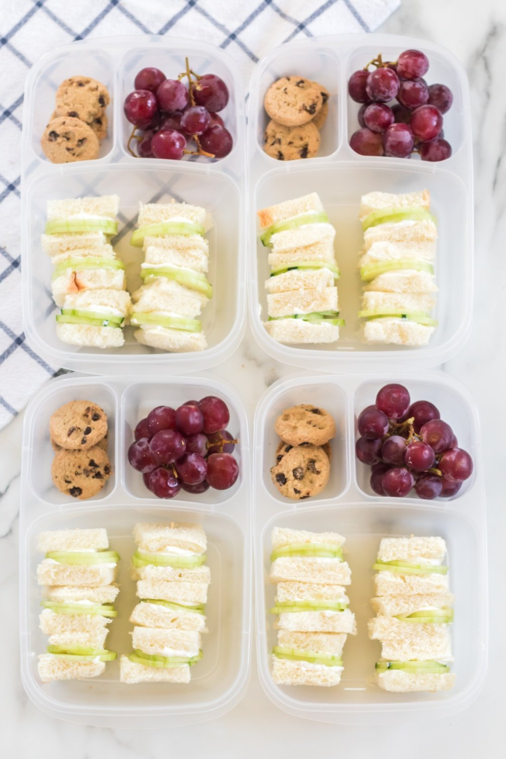 This mini cucumber sandwich lunchbox idea is a fun way to bring a little bright, elegant fun to your work or school lunch. via @familyfresh